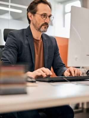 depositphotos_389534162-stock-photo-male-office-worker-looking-at